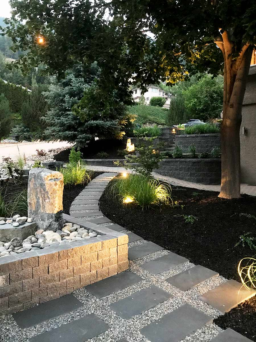 Xeriscape patio by Waterwise Design in Kelowna