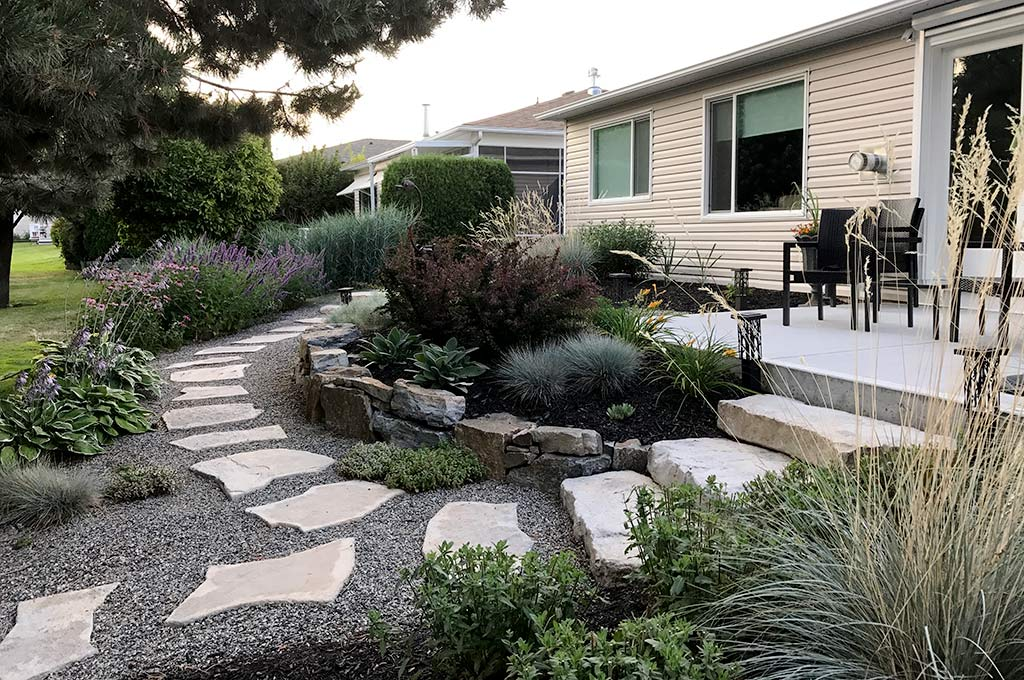 Stepping stone path through xeriscape rock garden after shot by Waterwise Design in Kelowna