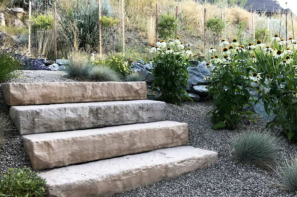 Natural-looking manufactured stone stairs provide even access after shot by Waterwise Design in Kelowna
